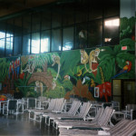 A large wall in the pool area turned into a jungle.