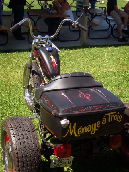 "An overview of the ""3"" themed Harley Flathead trike. Ivory and red pinstriping over satin black, 23K gold leaf lettering."