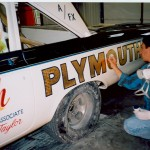 Bendi is outlining the 23K spun gold leaf lettering on this restored factory A/FX car.