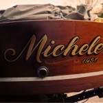 Gold lettering on a classic boat.